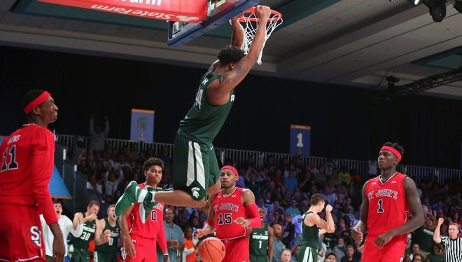 Michigan State Spartans forward Nick Ward dunks against St. John's in the second half of MSU's 73-62 win Wednesday, Nov. 23, 2016 in Nassau, Bahamas.