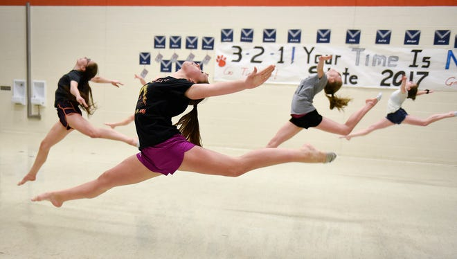 The St. Cloud Tech Tigerettes jazz dance team runs through its routine during practice Tuesday, Feb. 14.