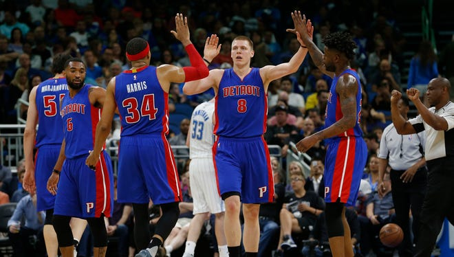 Apr 12, 2017; Orlando, FL, USA; Pistons forward Henry Ellenson (8) celebrates with forward Tobias Harris (34) and forward Reggie Bullock (25) against the Magic during the second half at Amway Center.