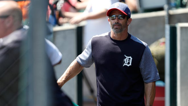 Tigers manager Brad Ausmus (7) walks in the dugout during the fourth inning of the Tigers' 11-8 loss Sunday at Comerica Park.