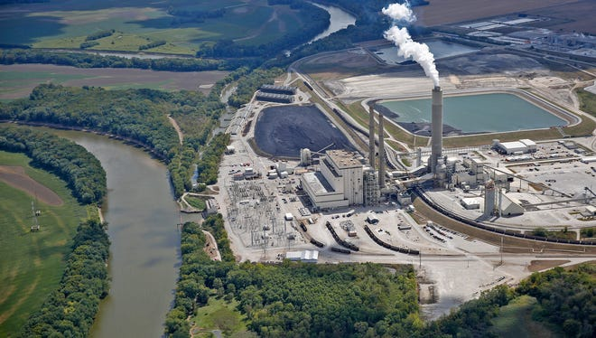 This is Duke's Cayuga Generating Station along the Wabash river, as seen from the air, Thursday, Sept. 7, 2017.  Two coal ash pits can be seen, including the one behind the smoke stacks.