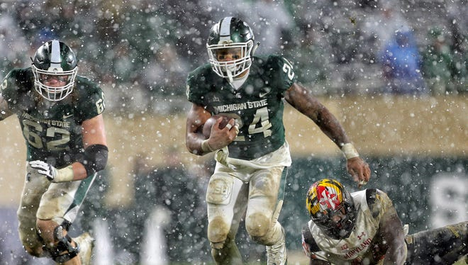 Michigan State Spartans running back Gerald Holmes runs the ball as Luke Campbell blocks in the second half against Maryland on Nov. 18, 2017 at Spartan Stadium.