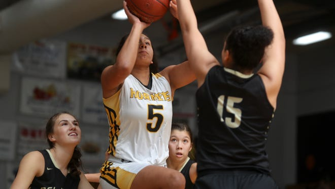 Entrerprise's Jadyn Matthews, center, goes up for a basket during the win over Del Norte Thursday at the opening night of the 2017 girls Harlan Carter Invitational.