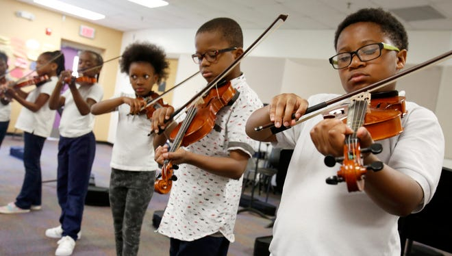 (L to R) Kemya Durell, Loraina Foster, Laurel King, Micheal Treadway and Jarell Brown all third graders in Sean Patton's band class at Duke Ellington at William J. Beckham Detroit Public School in Detroit, Michigan demonstrated with their one-fourth violins Ode to Joy.It is one of a few pieces her class is performing at their end of the year school concert on Wednesday, May 30th.Detroit Public Schools Community District is planning on revamping their feeder system and this school will be sending kids that enter ninth grade to Denby High School.