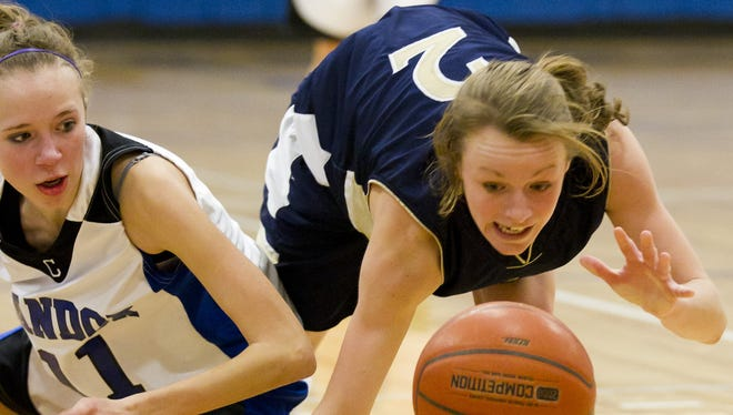 Notre Dame's Hannah Brackley, right, battles for a loose ball against Candor in 2011.