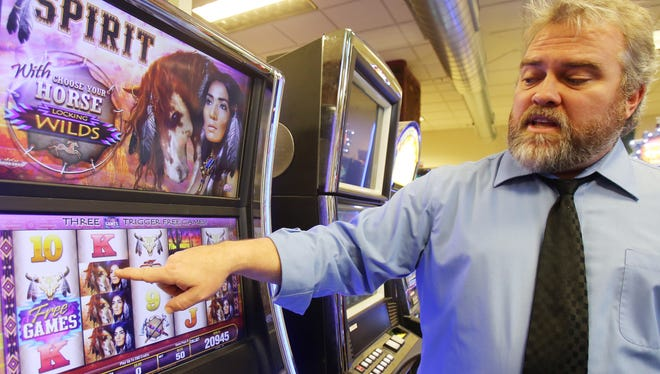 Chris Adams, 43, a manager of the Gaming Lab, explains how he and his fellow engineers test out slot machines and other games before approving them for casino use.