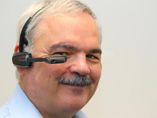 Vuzix CEO Paul Travers wears the firm's M100 Smart Glasses.