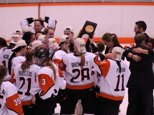 RIT celebrates its 4-1 win over Norwich in the NCAA Division III women's ice hockey championship game on March, 17, 2012.