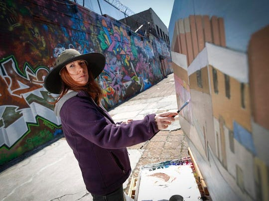 Valerie Larko working on a painting in the South Bronx