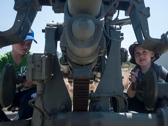 Children from Delaware play on a WWII gun in Fort Miles during Delaware Goes to Way day.