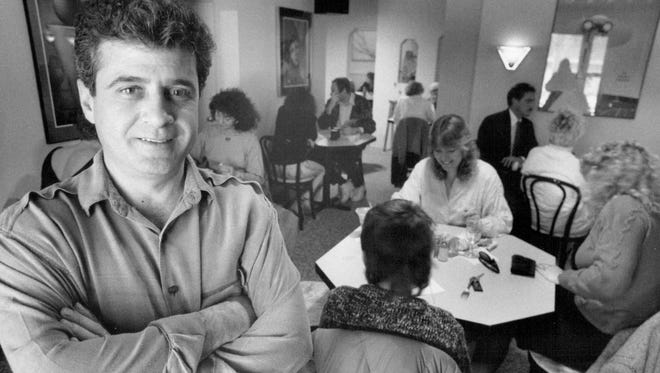 Looking back: Johnny Rebis was owner of the Yellow Rose. He was pictured in the remodeled first-floor dining room in April 1990.