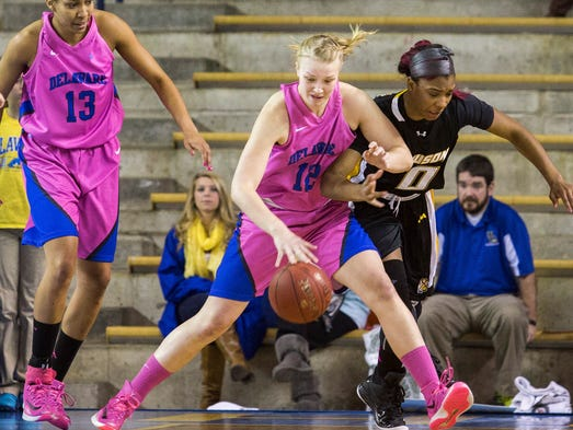 Delaware's Hannah Jardine (No. 12) steals the ball from Towson's LaTorri Hines-Allen in the first half of Delaware's 52-43 win over Towson at the Bob Carpenter Center on Sunday afternoon, February 16, 2014.