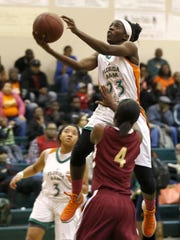 FAMU DRS senior Jazmine Jones lays the ball up over Florida High's Adrianna Long during their game Saturday. Jones had 27 points and 10 rebounds in a 72-47 win.