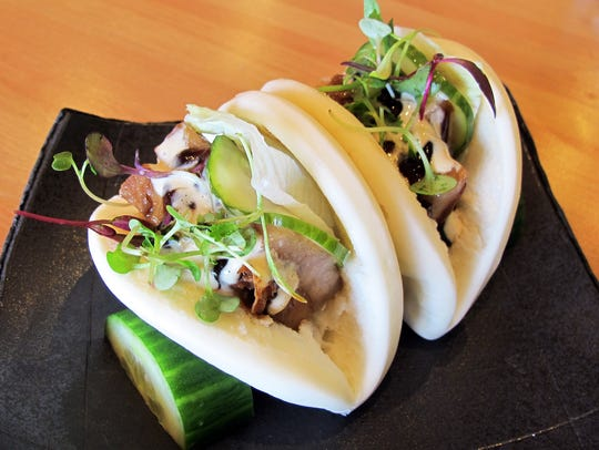 Berkshire pork belly buns are among the small plates