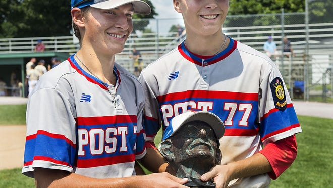 Former Ashland pitcher Alex Amalfi (right) and Kevin Balewicz hold a bust of Gandhi, which was given to the game's MVP after Ashland wins last summer. This summer, Ashland hands out a framed pictured of former player Andrew Sternick.