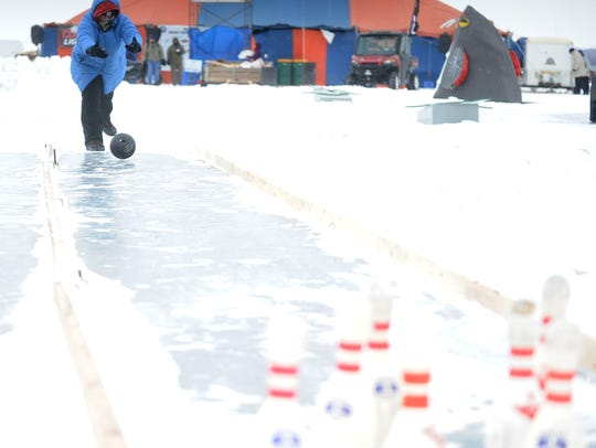 Elizabeth Ahborn of Fond du Lac bowls on the ice during 2015's Sturgeon Stampede.