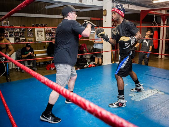 David Spikes, right, trains with Steve Douthitt at