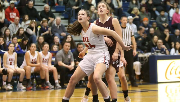 Rye's Ellie Dailey (24) boxes out under the basket