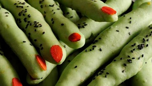 Ghoulish witches' fingers are made by adding green food coloring to refrigerated bread dough.