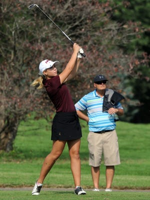 Lexi Bubenchik hits a tee shot on the back nine during the Division II district tournament on Wednesday at River Greens.