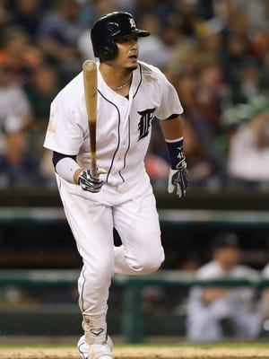 Tigers designated hitter Victor Martinez singles during the seventh inning of the Tigers' 9-6 win over the Twins on Wednesday at Comerica Park.