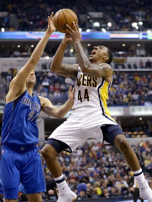 Indiana Pacers guard Jeff Teague (44) puts up a shot on Dallas Mavericks forward Dirk Nowitzki (41) in the first half of their game Wednesday, October 26, 2016, evening at Bankers Life Fieldhouse.
