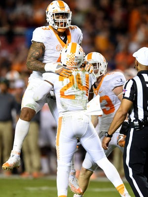 Tennessee defensive end Derek Barnett (9) and defensive back Todd Kelly Jr. (24) celebrate after a play during the first half Saturday, Oct. 29, 2016, at Williams-Brice Stadium in Columbia, S.C.