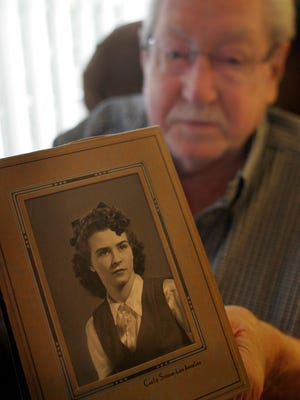 Jean Shaw, 95, holds his wife Helen Mae's high school graduation picture. His wife died on Valentine's Day. They were married 73 years.