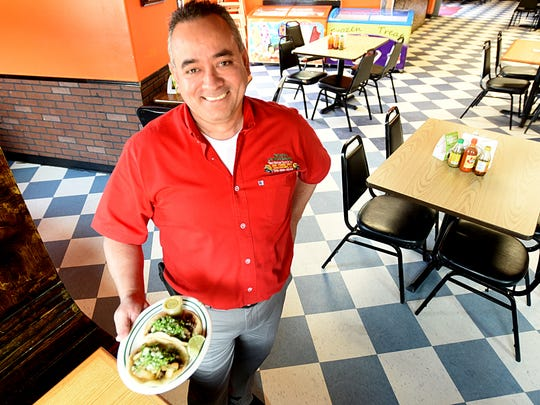 Jaime Munoz, owner of Taqueria La Michoacana holds the tacos they plan on making for Taco Wars.