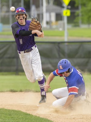 Jackson shortstop Petey Taylor forces Lake's Koby Miller at second as he turns a double play to end the top of the fifth inning during a May 21, 2019 game.
