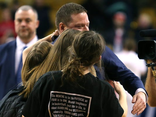 Texas Tech coach Chris Beard celebrates with his daughters after Texas Tech defeated Purdue 78-65 in an NCAA men's college basketball tournament regional semifinal early Saturday, March 24, 2018, in Boston. (AP Photo/Mary Schwalm)