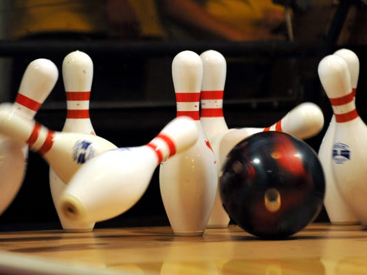 A bowling ball strikes the pins in the 1