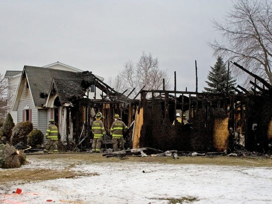 A woman was found dead after a raging a fire early
