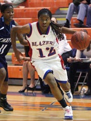 Teisha King of Americas High School made a break for the basket during the Trailblazers game against Chapin in 2008 at Americas.