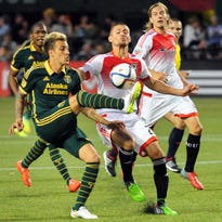 May 27, 2015; Portland, OR, USA; Portland Timbers midfielder Maximiliano Urruti (37) goes after a ball as D.C. United midfielder/defender Perry Kitchen (23) defends  during the second half of the game at Providence Park. The Timbers won the game 1-0. Mandatory Credit: Steve Dykes-USA TODAY Sports