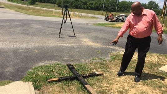 Pastor Vernon Woods arrived at Clarksville's New Hope Missionary Baptist Church to find a burned cross Tuesday morning.