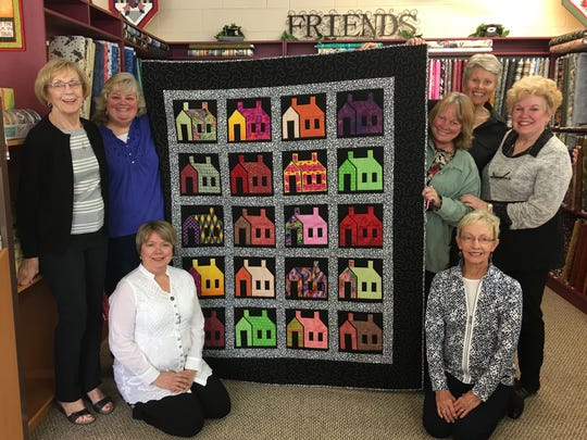 Local quilters from 'A Quilting Situation' show off a beautiful piece raffle off to help a local charity.