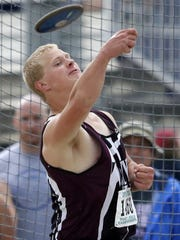 Caleb Rogalski, of Winneconne, releases the discus