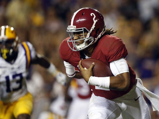 Alabama quarterback Jalen Hurts carries against LSU on Saturday in Baton Rouge, La. Alabama is No. 1 in the second edition of the College Football Playoff rankings.