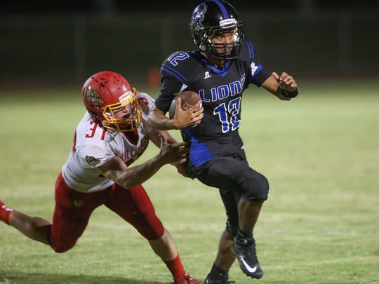 Cathedral City High School quarterback Nicandro Guardiola runs against Hemet, September 1, 2017.