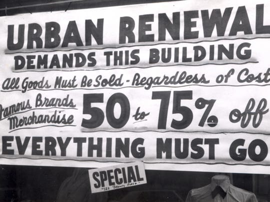 "A sign in a Front Street store proclaims ""everything must go"" because of Urban Renewal in 1965."