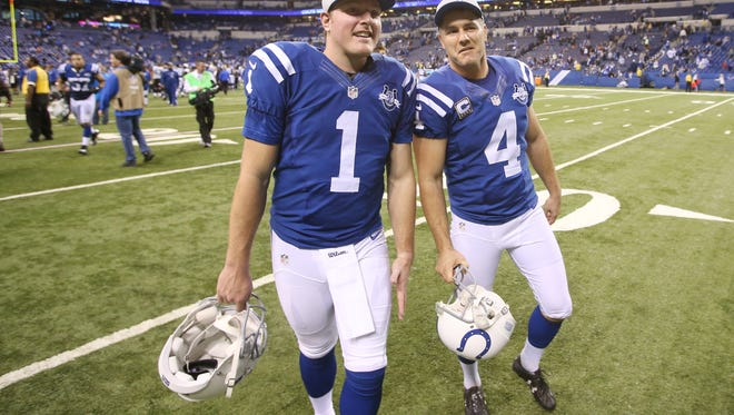 Colts kickers Pat McAfee and Adam Vinatieri walk off the field after the Colts defeated the Jaguars 30-10. Vinatieri passed the 2000 points mark during the game. The Indianapolis Colts hosted the Jacksonville Jaguars at Lucas Oil Stadium Sunday, December 29, 2013.