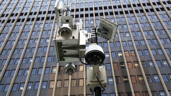 Security cameras operated by the Department of Homeland Security are installed in front of a federal building in New York.