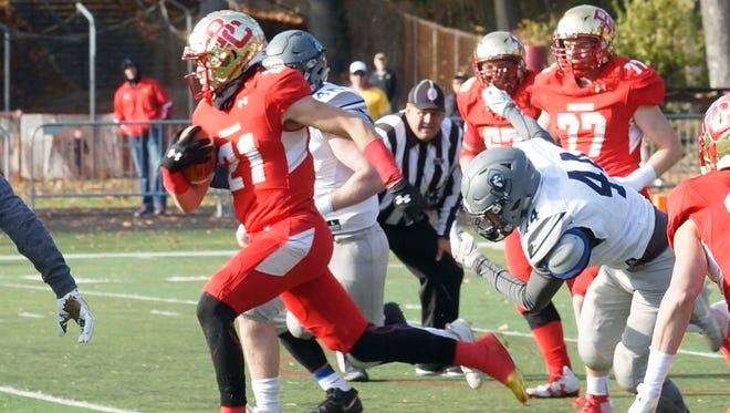 Johnny Langan (21) ran for 211 yards and three touchdowns in Bergen Catholic's 56-21 win over St. Augustine Prep.