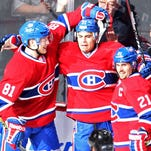 Montreal Canadiens left wing Rene Bourque (17) celebrates with center Lars Eller (81) and right wing Brian Gionta (21).