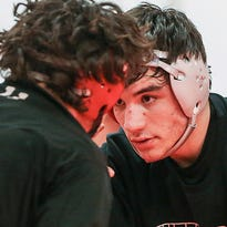 The Mappes family has made its mark on Center Grove wrestling, from the bus to the mat