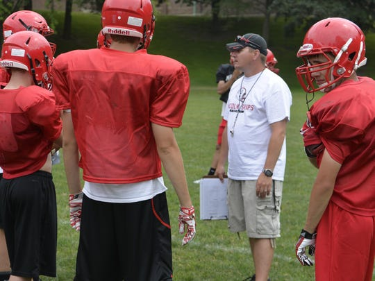 New Manitowoc Lincoln football coach Rick Ducat addresses his team during practice in July.