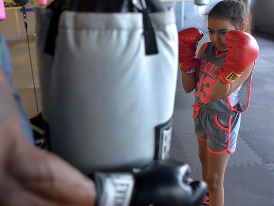 Vila Boxing owner David Anthony works out with daughter