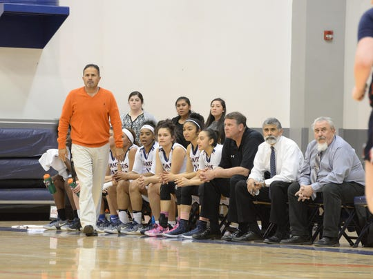 COS women's head coach Ray Alvarado watches a game near the Giants' bench earlier this season at Porter Field House.