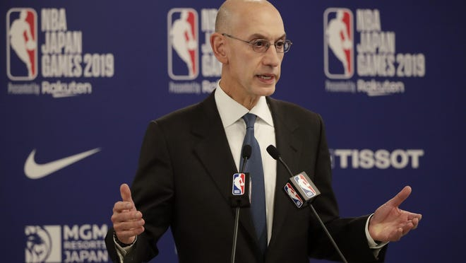 NBA Commissioner Adam Silver speaks at a news conference before a 2019 preseason game between the Houston Rockets and the Toronto Raptors in Japan.